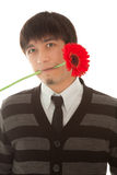 Man with gerbera in his mouth Stock Images