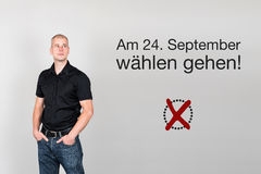 Man with german appeal to vote at german federal election 2017. Man next to appeal in german to go voting during german federal election in September 2017 Royalty Free Stock Photo