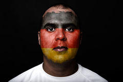 Man with Germany flag. Painted on her face on black background Royalty Free Stock Image