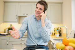 Man gesticulating while calling Stock Photography