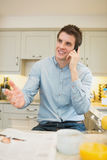 Man gesticulating while phoning Stock Photo