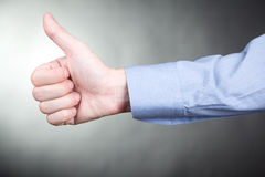 Man gesturing approval thumbs up sign Stock Image