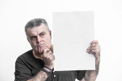 Man gesturing with blackboard isolated on white background Royalty Free Stock Photos