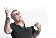 Man gesturing with blackboard isolated on white background Stock Images