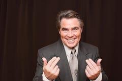 Man gesturing at the camera Stock Photo
