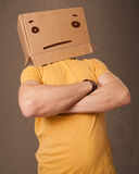 Man gesturing with a cardboard box on his head with straig Stock Photo
