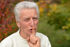 Man gesturing finger on lips silence. Senior man gesturing finger on lips silence Royalty Free Stock Photography