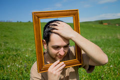 Man gesturing through frame. Stock Photography