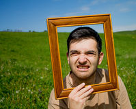 Man gesturing through frame. Royalty Free Stock Photo