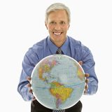 Man gesturing with globe. Royalty Free Stock Photo