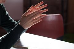 man gesturing hands at business meeting Stock Image