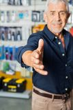 Man Gesturing Handshake In Hardware Store Stock Photos