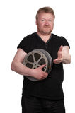 Man gesturing, holding film reels Royalty Free Stock Photo