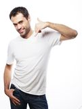 Man gesturing mobile phone near his face Stock Photography
