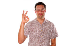 Man gesturing ok. Man using his hand to make the sign for ok Royalty Free Stock Photos