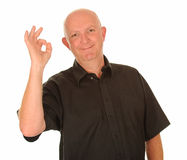 Man gesturing okay. Man holds his hand up in a gesture of approval Stock Image