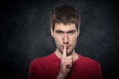 Man gesturing silence. Stock Photo