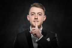 Man gesturing silent. Royalty Free Stock Photos