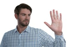 Man gesturing stop sign against white background. Handsome man gesturing stop sign against white background Stock Image