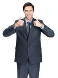 Man gesturing a success sign against white Royalty Free Stock Photos
