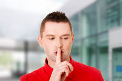 Man gesturing to be quiet. With finger Stock Images