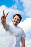 Man gesturing victory sign Royalty Free Stock Photos