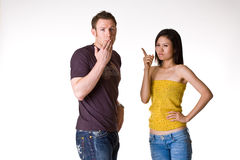 Man get scolded by his spouse. Caucasian man get scolded by his angry spouse stock image