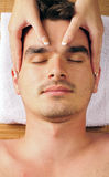 Man geting a face massage Stock Images