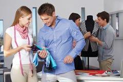 Man gets advice at custom tailor Stock Photo