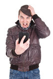 Man gets a angry message on smartphone Stock Photography