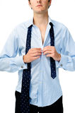 Man gets dressed for work Stock Image