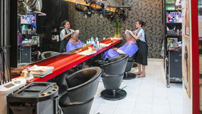 Man gets a hairwash at the hairdresser. SINGAPORE - AUG 11, 2015: man gets a hairwash at the hairdresser in Singapore. Hairdresser in asian contries offer mostly Stock Images
