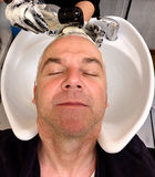 Man gets his hair dyed. At a hairdresser royalty free stock images