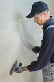 Man gets manually gypsum plaster Royalty Free Stock Images