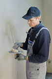 Man gets manually gypsum plaster Stock Images