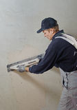 Man gets manually gypsum plaster Stock Photography