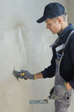 Man gets manually gypsum plaster Royalty Free Stock Photos