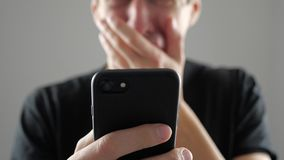 Man Gets a Message with an Unpleasant Shocking News. He is Scared and Upset.. Bad News.