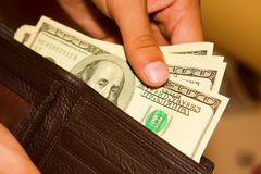 Man gets money from  purse Stock Images
