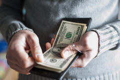 Man gets money from the wallet Stock Image