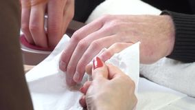Man gets nails manicure at beauty salon stock video footage