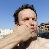 Man gets punched in the face Royalty Free Stock Photography