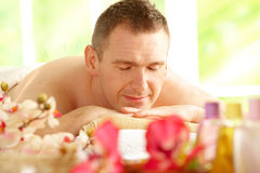 Man getting acupuncture treatment in a spa Stock Images