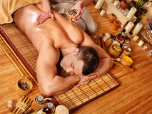 Man getting aroma massage in spa Stock Photos