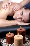 Man getting a back massage lying down Stock Photography