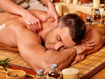 Man getting bamboo massage Stock Photography