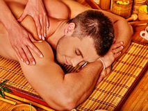 Man getting bamboo massage Royalty Free Stock Photos