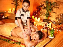 Man getting bamboo massage. Stock Images