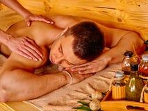 Man getting bamboo massage Stock Photos
