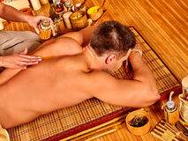 Man getting bamboo massage Royalty Free Stock Image